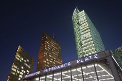 Potsdamer Platz At Night. Potsdamer Platz train station entrance and skyscrapers at night Stock Photography