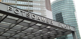 Potsdamer Platz sign Berlin. Low angle view of Potsdamer Platz sign with modern high rise buildings in background, Berlin, Germany Royalty Free Stock Photography