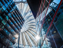 Potsdamer Platz Sony Center in Berlin. Low angle interior view of sun coming through the ceiling of Potsdamer Platz Sony Center in Berlin Stock Images