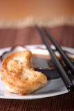 Potsticker and chopsticks Royalty Free Stock Photos