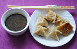 Potstickers and dipping sauce Royalty Free Stock Photo