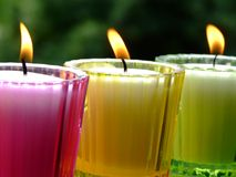Potted candles. Colored glass potted candles Royalty Free Stock Photography