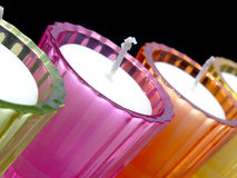 Potted candles. Colored glass potted candles Stock Images