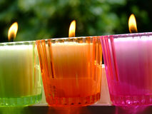 Potted candles. Colored glass potted candles Royalty Free Stock Image