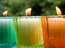 Potted candles. Colored glass potted candles Stock Photos