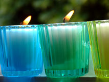 Potted candles. Colored glass potted candles Royalty Free Stock Photo