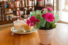 Potted flowers on a table. In a cafe Royalty Free Stock Image