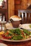 Potted lamb and salad, Cappadocia cuisine Stock Photography