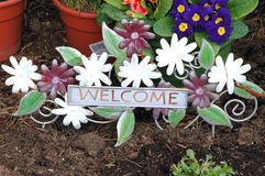 Potted plants. Potted flower plants with a welcome sign attached Royalty Free Stock Images