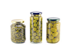 Potted preserved canned olives and asparagus beans in glass jars Royalty Free Stock Image