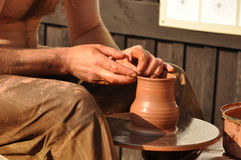 Potter. Demonstrating how to create an earthen vase Royalty Free Stock Photo