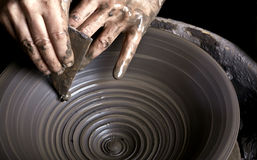 Potter. Hands of a potter, creating an earthen jar on the circle stock images
