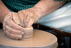 The Potter. A potter creating a vase out of lump of clay Royalty Free Stock Images