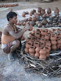 Potter builds an outdoor kiln Royalty Free Stock Image