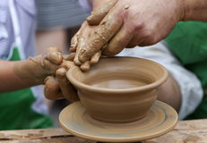 Potter Clay Bowl Child Hand Stock Photos