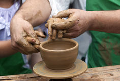 Potter Clay Bowl Child Hand Stock Image