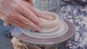 Potter Creates the Product on a Potter`s Wheel. on the Potter`s Lathe Spinning Pottery. Artist Operate Hands. Hands Gently Create. Correctly Shaped Handmade stock footage