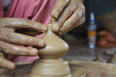 Potter creating lamp on pottery wheel. Close up Royalty Free Stock Images