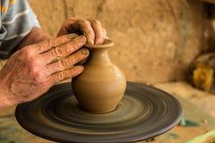Potter creating a new ceramic pot Royalty Free Stock Photos