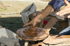 Potter hands guides the child`s hand. To help him to work with a Potter`s wheel Stock Photography
