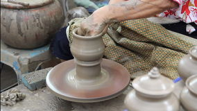 Potter hands making in clay on pottery wheel stock video