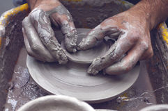 Potter hands wheel pottery. Work workshop Stock Photo