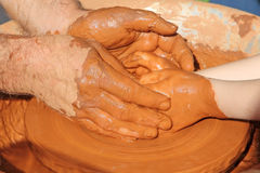 Potter hands wheel pottery work workshop teacher and little pupil Stock Images