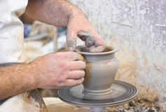 Potter hands and wheel Royalty Free Stock Images