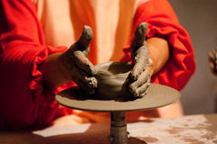 Potter. Hands working in a clay pot Royalty Free Stock Photo