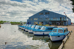 POTTER HEIGHAM, NORFOLK/UK - MAY 23 : View of Blue Boats for Hir. E at Potter Heigham in Norfolk on May 23, 2017. Unidentified people Royalty Free Stock Image