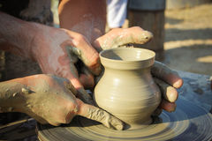 Potter helps the child to make a vase from clay Royalty Free Stock Image