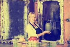 Potter holding black glazed ceramic Royalty Free Stock Image