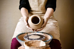 Potter holds more crude to the firing of white clay jug Royalty Free Stock Photos