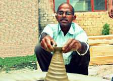 A potter in India. A potter from a village in India royalty free stock photo