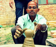 A potter in India. A potter from a village in India royalty free stock photography