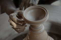 Potter makes earthen lamps or 'diyas' ahead of the forthcoming Diwali festival Royalty Free Stock Images