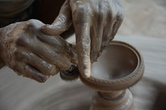 Potter makes earthen lamps or 'diyas' ahead of the forthcoming Diwali festival Stock Images