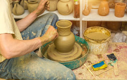 Potter makes earthen vessel. The potter makes earthen vessel close up Royalty Free Stock Image