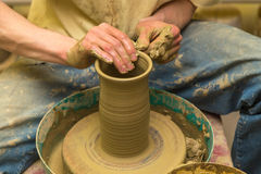 Potter makes earthen vessel. The potter makes earthen vessel close up Royalty Free Stock Photo