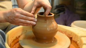 Potter makes a pot of clay. stock video footage