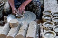 Potter makes on the pottery. Royalty Free Stock Images
