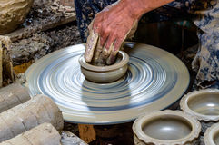 Potter makes on the pottery. Stock Photos