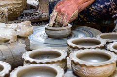 Potter makes on the pottery. Stock Images