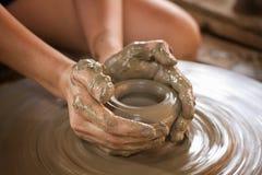 Potter makes on the pottery wheel Royalty Free Stock Photos