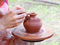 Potter makes on pottery wheel clay pot. Stock Image