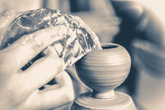 Potter makes a pretty small vase from clay Royalty Free Stock Images