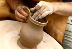 Potter making clay jug Stock Images