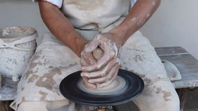 Potter making a clay jug stock video