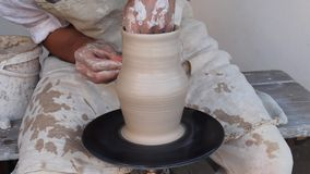 Potter making a clay jug stock video footage