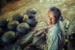Potter  making clay pot. Royalty Free Stock Image